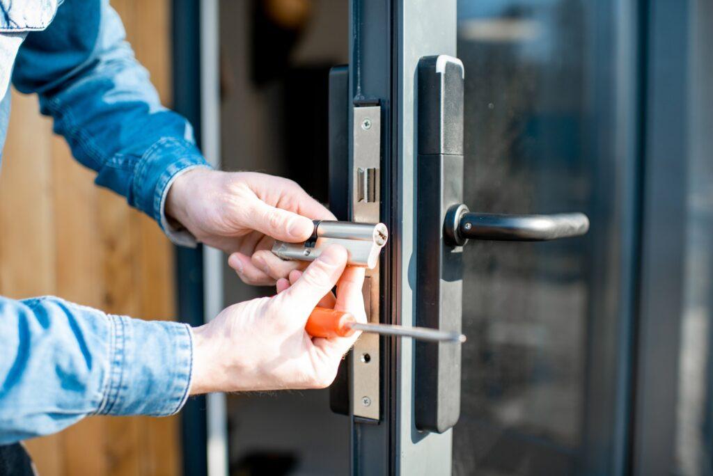 Man changing core of a door lock